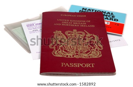 UK identification papers - passport, medical card, driving license, NI card, isolated on white background. - stock photo