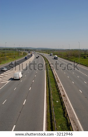 UK motorway traffic including cars and trucks. - stock photo