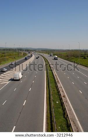 UK motorway traffic including cars and trucks. - stock photo