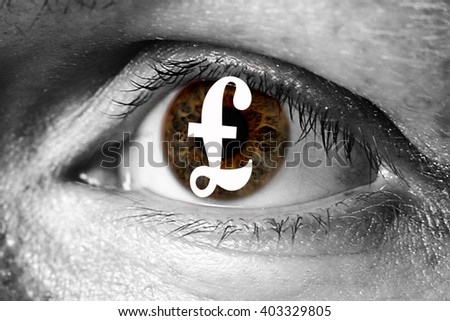 UK pound money sign in big eye extreme greed illegal immigrant closeup - stock photo