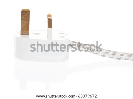 UK power plug isolated with clipping path with reflections - stock photo