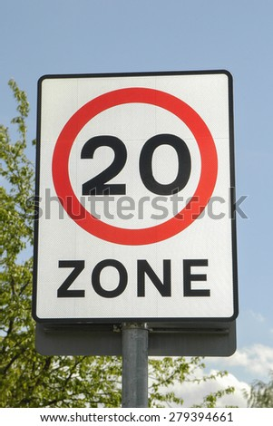 UK road sign with a 20 mph zone limit - stock photo