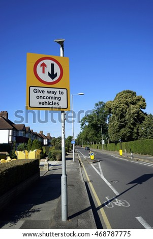 UK, Road Traffic Sign, give way to oncoming vehicles sign.