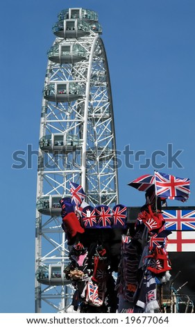 UK tourist souvenirs with london eye as background - stock photo
