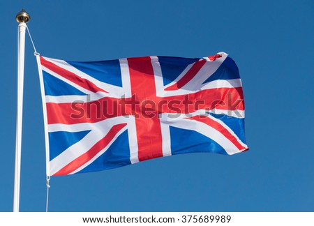 UK Union Flag of Great Britain blowing in the wind. - stock photo