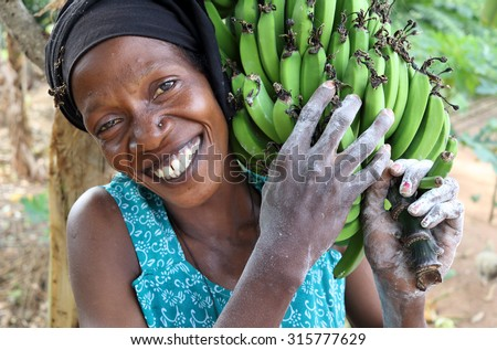 UKEREWE ISLAND - TANZANIA - JULY 4, 2015: Unidentified woman carrying bananas on July 4, 2015 in a rural village on Ukerewe Island, Lake Victoria, Tanzania - stock photo