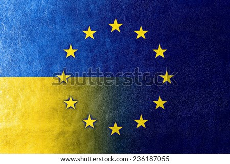 Ukraine and European Union Flag painted on leather texture - stock photo