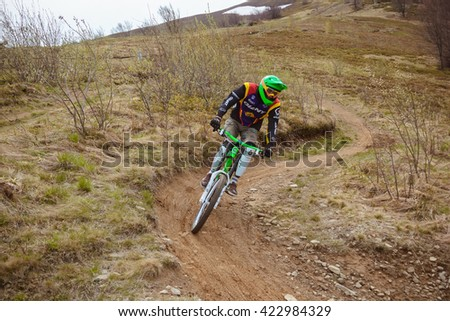 Ukraine. Carpathian Mountains. Village Pylypets. May 2 2016. Check cyclists on mountain descent, extreme riding - stock photo