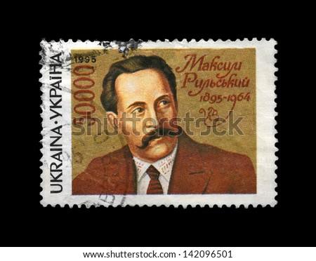 UKRAINE - CIRCA 1995: canceled stamp printed in Ukraine, shows famous ukrainian poet, writer Maksym Rylskyi (1895-1964), circa 1995. vintage post stamp isolated on black background. - stock photo
