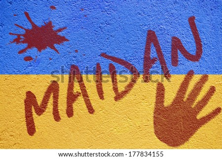 Ukraine flag graffiti painted on old concrete coated wall with MAIDAN (the riots camp at Independence square in Kiev) inscription