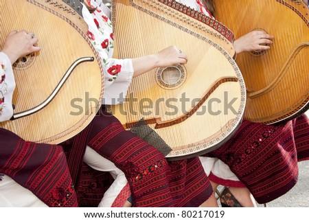 ukraine girls play a musical stringed instrument - stock photo