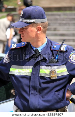 UKRAINE, KIEV - MAY 9: Ceremonial parade at Kiev main street - Khreshchatyc - dedicated to the 65th Anniversary of victory in Great Patriotic War. Ukranian policeman. May 9, 2010 Kiev.