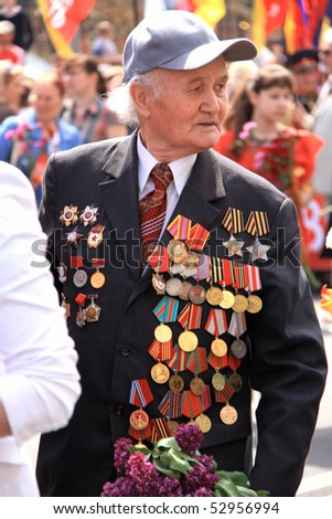 UKRAINE, KIEV - MAY 9: Ceremonial parade at Kiev main street - Khreshchatyc - dedicated to the 65th Anniversary of victory in Great Patriotic War (World War II). Parade of victory. Kiev, May 9, 2010.