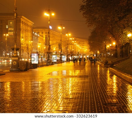 UKRAINE, KIEV - OCTOBER 28, 2015: Rainy Kreschatyk street in the evening - the central street of the capital of Ukraine, Kiev