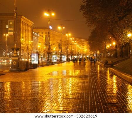 UKRAINE, KIEV - OCTOBER 28, 2015: Rainy Kreschatyk street in the evening - the central street of the capital of Ukraine, Kiev - stock photo