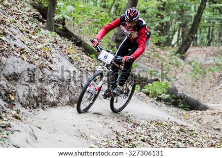 "UKRAINE, KIEV - OCTOBER 10: Unknown amateur biker with blurred background, at the amateur bicycle competition ""Dubki"" closing, on October 10, 2015 in Ukraine, Kiev. - stock photo"