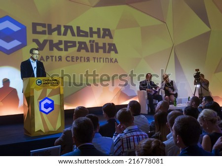 "UKRAINE, KYIV - September 11, 2014: Speaker economist Igor Umansky onhe Congress of party ""Strong Ukraine"". Congress delegates approved a program and the list of candidates in majority districts - stock photo"
