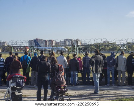 UKRAINE, KYIV - September 28, 2014: Visitors to the museum watching a passenger plane taking off. -- National Aviation Museum is the youngest military-technical museum in Ukraine.  - stock photo