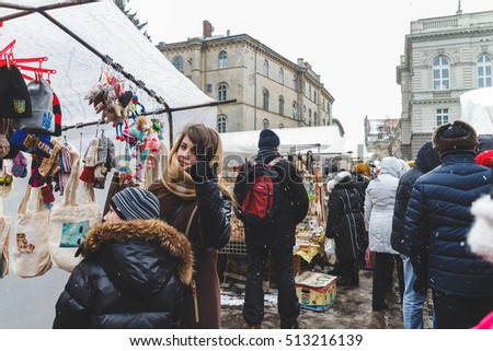 Ukraine, Lviv - JANUARY 4, 2015: Residents and tourists in the streets of Lviv.