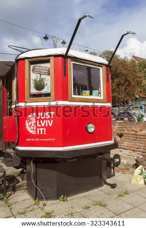 UKRAINE, LVIV - SEPTEMBER 27, 2015: A touristic tram which is a shop to buy different things and souvenirs and also coffee, Lviv, Ukraine - stock photo