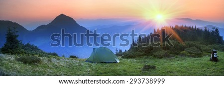 Ukraine - Marmarosh mountain when the snow melts and becomes warmer - in the spring and summer is pleasant to put up tents on the top of the mountain - it's fantastic fairytale beautiful and romantic - stock photo
