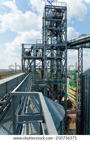 Ukraine, Odessa - AUGUST 2, 2014: Towers of grain drying enterprise. metal grain facility with silos