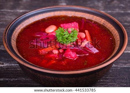 Ukrainian and russian national food - red beet soup, borscht . Close up - stock photo