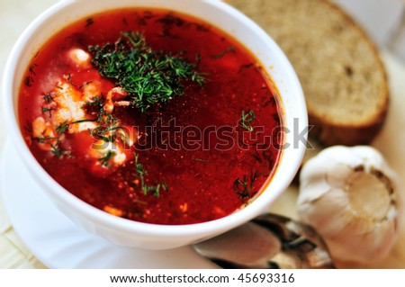 ukrainian and russian red-beet soup (borscht) with garlic and sour cream