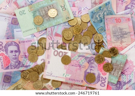 Ukrainian coins and money bills on banknotes background - stock photo