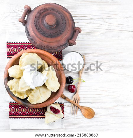 Ukrainian dumplings with cabbage, cheese and cherries