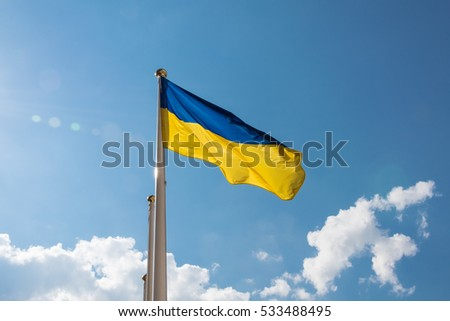 Ukrainian flag fluttering in the sky