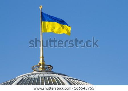 Ukrainian flag on a parliament roof in Kiev - stock photo