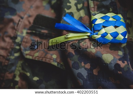 Ukrainian flag on tape uniform - stock photo