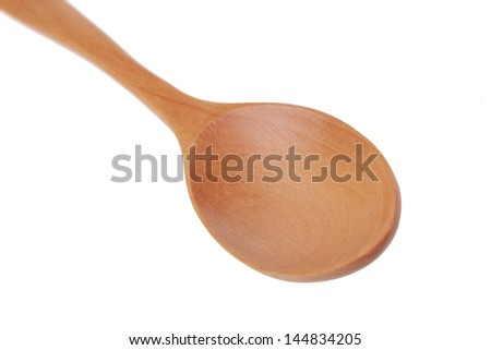 Ukrainian folk wooden spoon on a white background