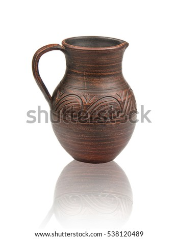 Ukrainian folklore ceramic jug on white background with reflection