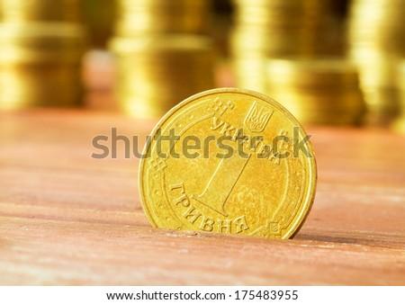 Ukrainian hryvnias, heap of coins/Ukrainian steel coin denominations of 1 hryvnia - stock photo