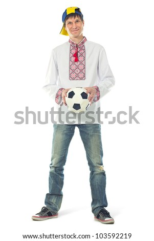 Ukrainian man in the national shirt with a ball on a white background - stock photo