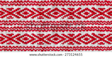Ukrainian national embroidery red thread - stock photo