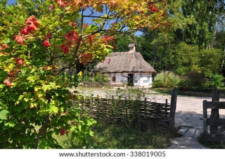 Ukrainian Picturesque hut. Traditional house in the Ukrainian village - stock photo