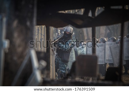 Ukrainian riot police firing rifles with rubber bullets by the revolutionaries. Ukraine, Kiev, street Hrushevskoho (01/20/2014)