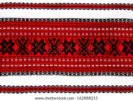 Ukrainian traditional red and black ornament embroidery closeup - stock photo