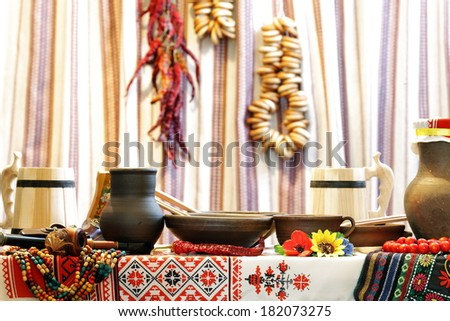 Ukrainian utensils placed in national style - stock photo