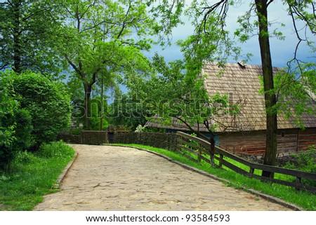 ukrainian village old street on highland at spring - stock photo