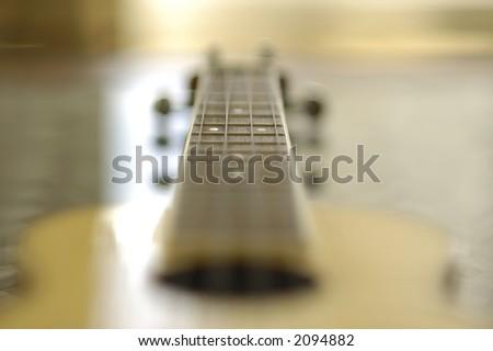 ukulele guitar fret board detail - stock photo