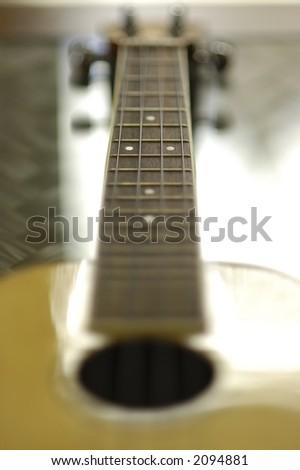 ukulele guitar fretboard detail - stock photo