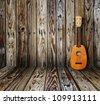 Ukulele in vintage wood room. - stock photo