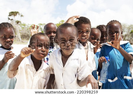 Ukunda, Kenya - March 29: Group of school children on hot bright sunny beach and enjoying the outdoors on March 29, 2011. - stock photo