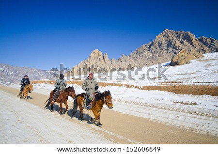 ULAANBAATAR: MONGOLIA - FEB 25: Nomads riding on their faithful horses, Ulaanbaatar on February 25, 2012, The horse's breed is purported to be largely unchanged since the time of Genghis Khan