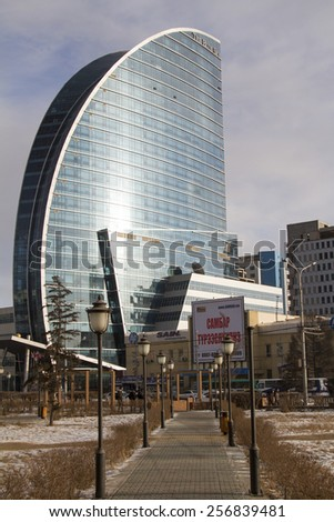 ULAANBAATAR, MONGOLIA - FEBRUARY 1: The building is a five star hotel with a glass facade on February 1, 2015 in Ulaanbaatar. - stock photo