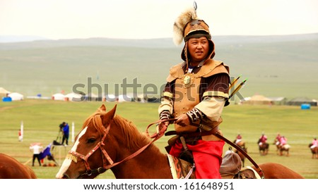 ULAANBAATAR, MONGOLIA - JULY 2013: Naadam Festival Horse Archery Crew with horse and traditional medieval outfit, posing - stock photo